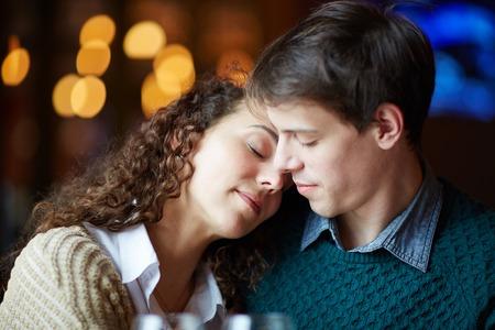 leaning: Amorous female leaning on her boyfriend shoulder