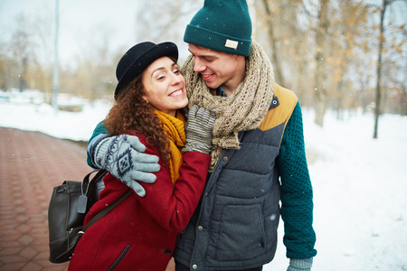 Young valentines having outdoor date on winter day Stock Photo