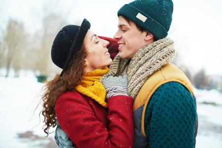 flirty: Flirty couple enjoying winter day Stock Photo