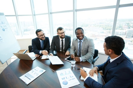 Confident employees offering businessman to sign contract photo