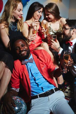 Glamorous people enjoying xmas party Stock Photo