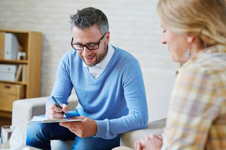 Experienced psychologist analyzing his patient story Stock Photo