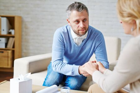 Mature man reassuring his female patient after talk