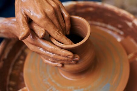 pottery: Hands of master making clay pottery
