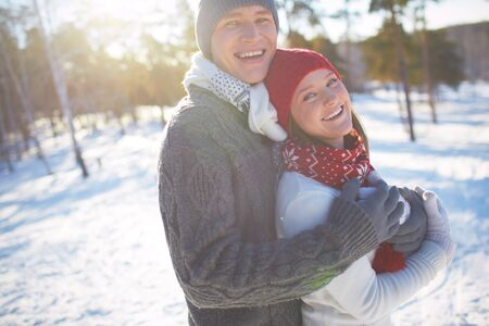 Laughing couple spending wintery day in park photo