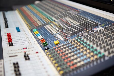 regulating: Soundboard with many buttons, for tuning, mixing sounds, regulating volume and adjusting audio frequencies