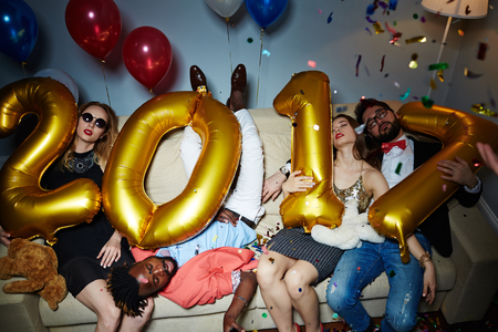 clubber: Tired friends sleeping on couch after new year party