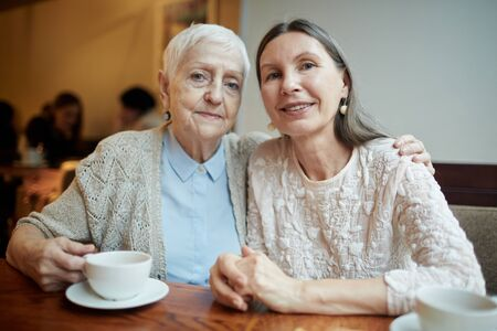 carefree: Two friendly grandmas having tea in cafe