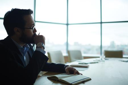 asian business man: Pensive man thinking of working plan Stock Photo