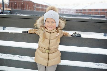 winterwear: Little girl in winterwear spending leisure outdoors
