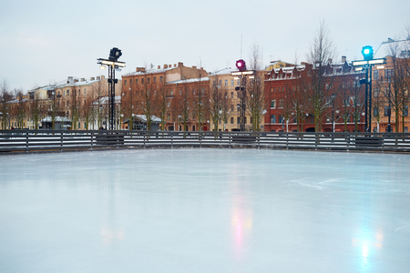 ice surface: Empty skating rink in urban environment Stock Photo