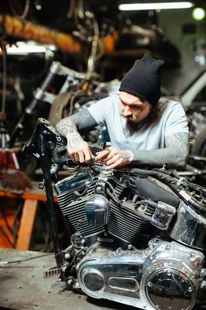 Specialist repairing motor bike engine