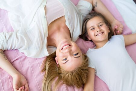 Happy mother and daughter expressing enjoyment photo