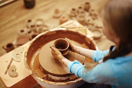 pottery: Girl learning how to make pottery