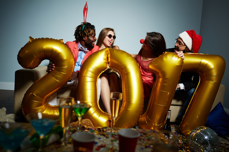 Carefree friends talking and laughing at party Stock Photo