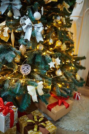 newyear: Decorated firtree and xmas gifts