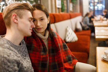 sexual relations: Amorous dates having rest in cafe Stock Photo