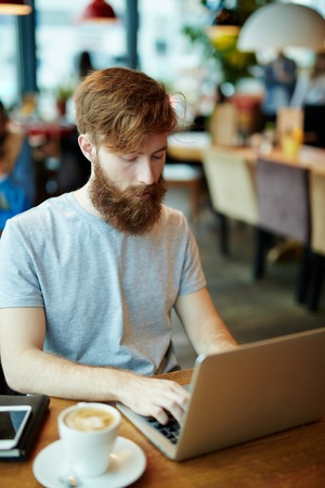 Young businessman networking in coffee-shop