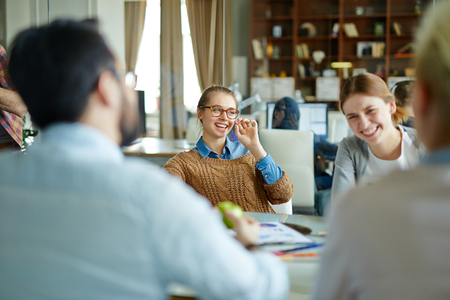economists: Young economists consulting at meeting Stock Photo