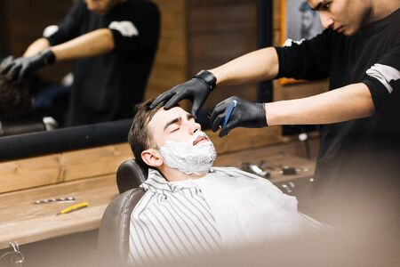 Shaving beard of guy Stock Photo