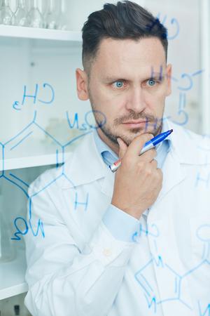 chemist: Pensive chemist Stock Photo