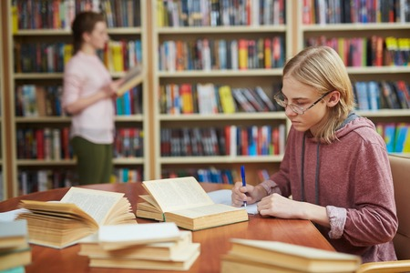 Guy in college library Stock Photo