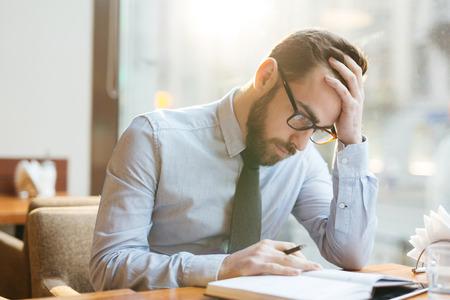 businessman thinking: Businessman thinking hard
