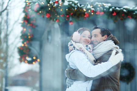 Embrace in snowfall Stock Photo