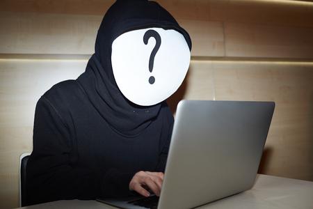 spammer: Hacker in black hoodie Stock Photo