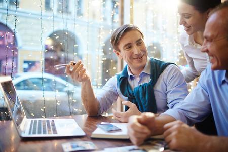 economists: Designers interacting Stock Photo