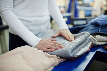 woman clothes: Working in dry-cleaning shop Stock Photo
