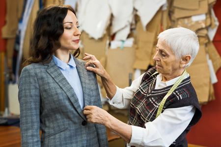 customer tailor: Businesswoman and tailor