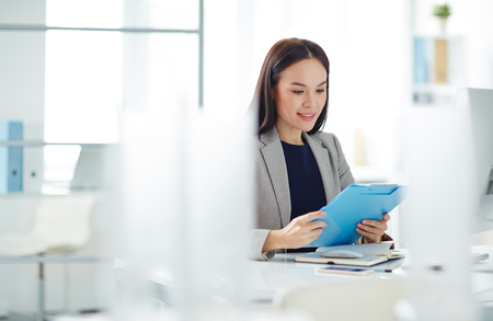PRETTY WOMEN: Young Asian Businesswoman in Office Stock Photo