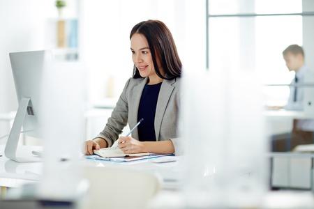 working desk: Beautiful Businesswoman in Office