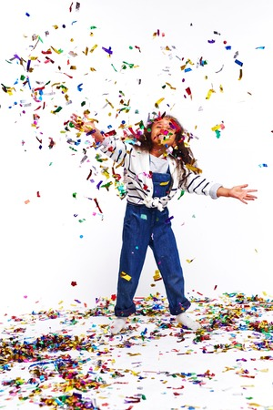 Happy Child Throwing Confetti Stock Photo