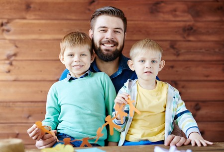 Family portrait of father and two sons
