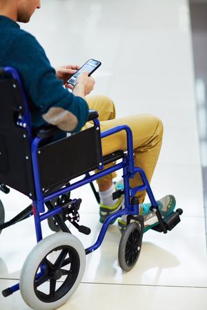 crippled: Handicapped using smartphone Stock Photo
