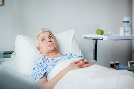 Resting Elderly Woman in Clinic Stock Photo