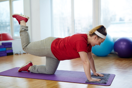 Obese Woman Doing Glute Kickback Exercise