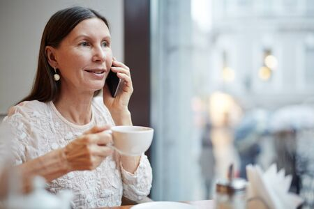 mature women: Mobile woman Stock Photo