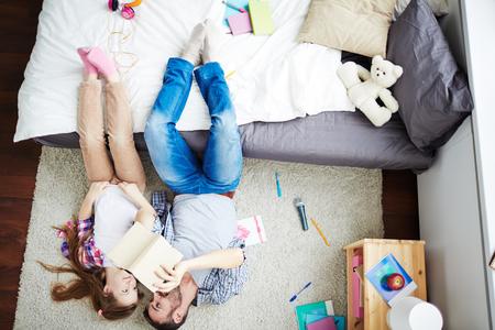 girl legs: Adventure dreamers lying on carpet