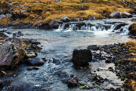 destination scenics: Waters of wild river and stones Stock Photo