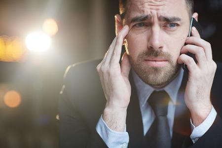 phone calls: Stressed Businessman Making Phone Calls