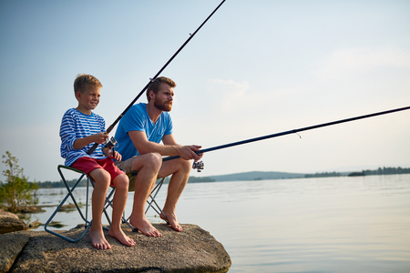 Father and Son Fishing Together  in Still Waters