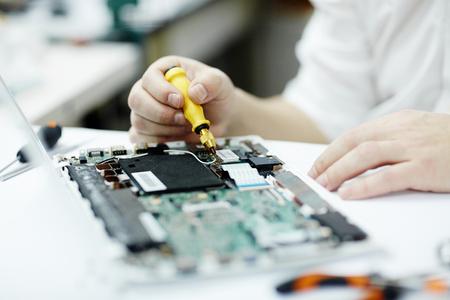 Man Working on Electronics