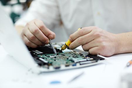 Male Hands  Repairing Laptop Stock Photo