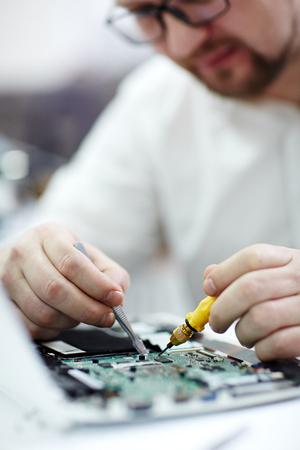 Closeup of Man   Repairing Laptop