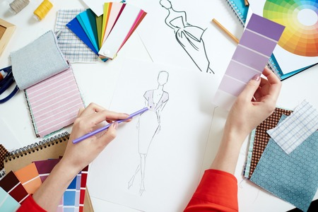 Fashion designer sketching new creative clothes