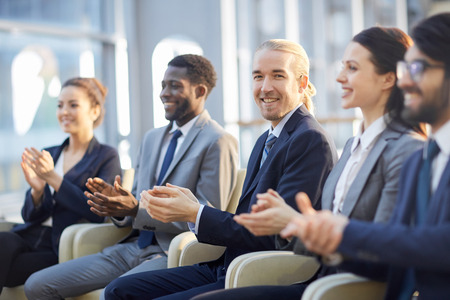 Smiling Business Audience Clapping