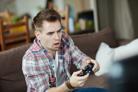 Adult Video Game Player Stock Photo
